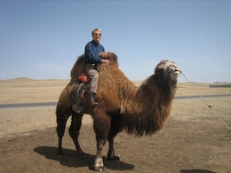 Paul Yoo, workshop coordinator and special assistant to Far East District engineering division chief, experiences a part of the Mongolian culture, riding a camel.