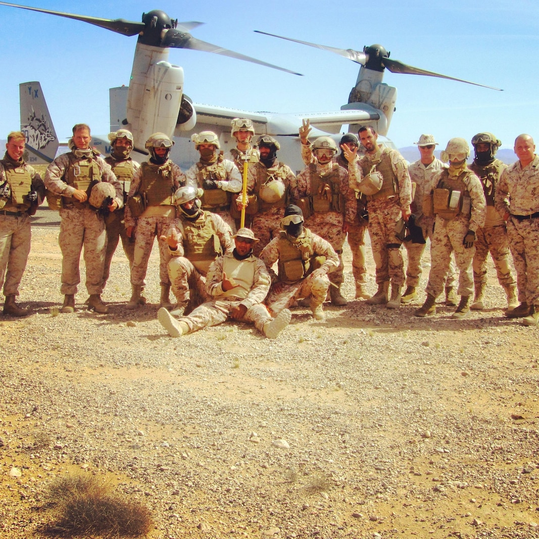 (CLB-7 Marines from left) Cpl Matthew Mottishaw, Chaplain Michael Slaughter, Cpl James Heres, Sgt Kenneth Sullivan, Cpl Alfredo Limon, 1stLt Tiffany Aguiar, and 1stSgt Alex Garcia after conducting Helicopter Support Team Training with the United Arab Emirates Presidential Guard.