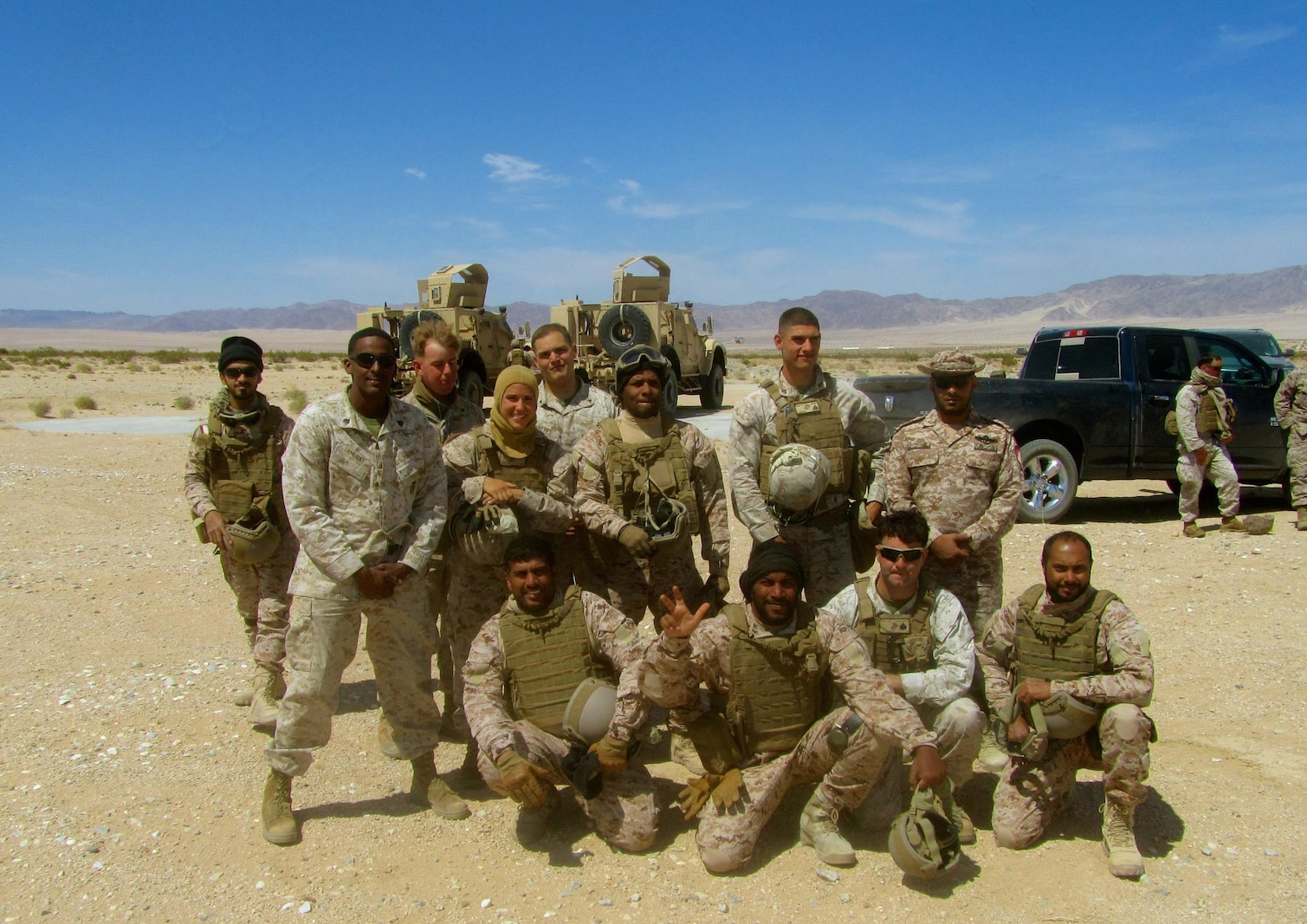 (CLB-7 Marines from top left) Cpl James Heres, Cpl Matthew Mottishaw, Sgt Kenneth Sullivan, 1stLt Tiffany Aguiar, and Cpl Alfredo Limon on Day 2 of Helicopter Support Team Training with the United Arab Emirates Presidential Guard.