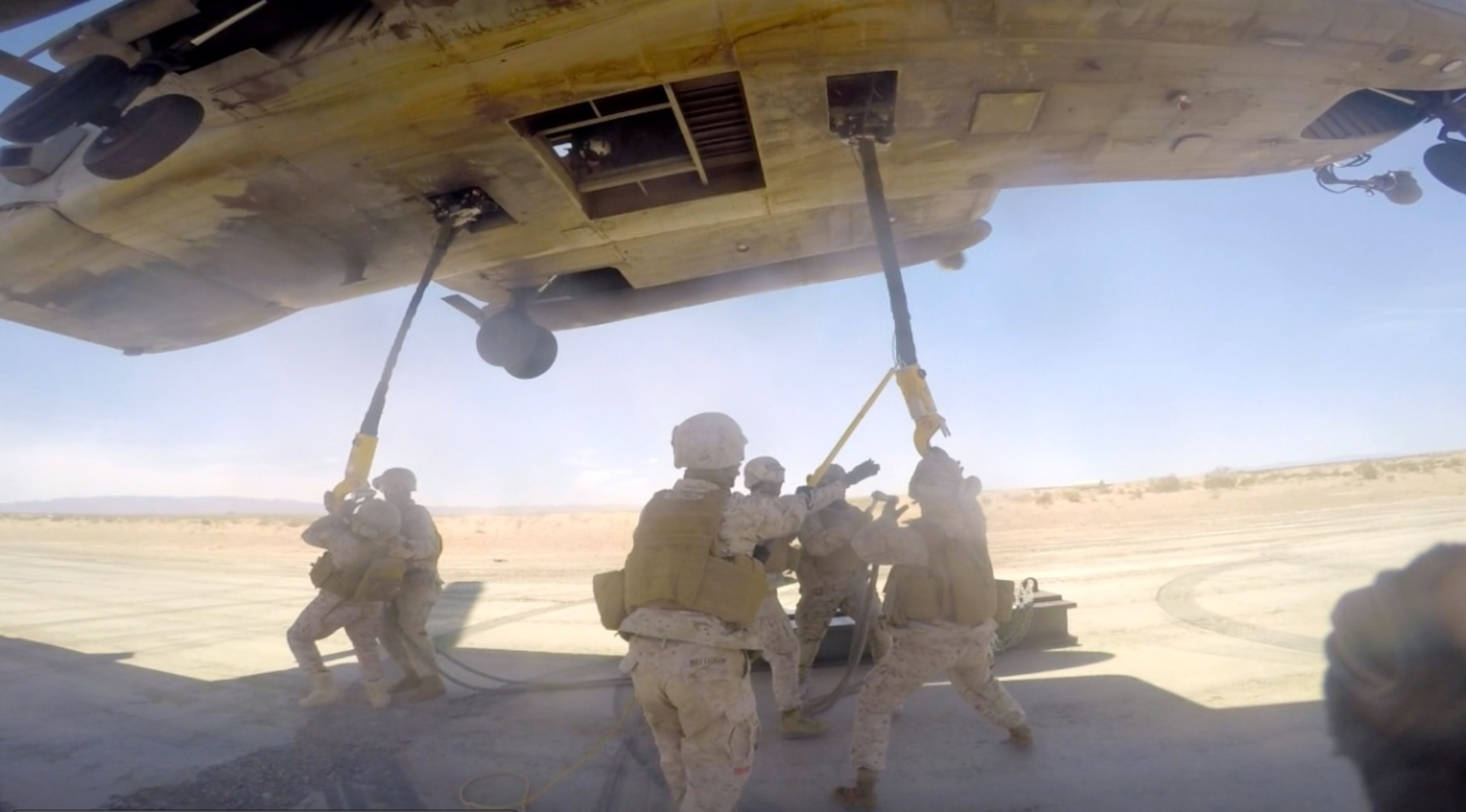CLB-7 Landing Support Platoon Sergeant, Sgt Kenneth Sullivan instruct United Arab Emirates' Logisticians on utilizing hand and arm signals in the Outside Director position on a Helicopter Support Team.