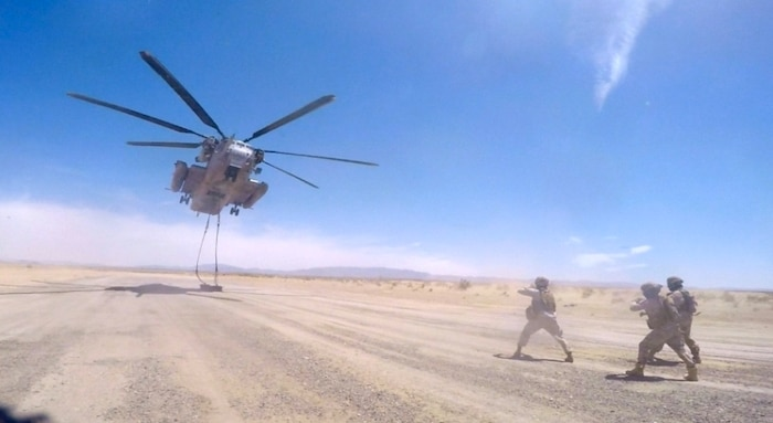 CLB-7 Landing Support Marines; Cpl Matthew Mottishaw, Chaplain Cpl James Heres, Sgt Kenneth Sullivan, Cpl Alfredo Limon, and 1stLt Tiffany Aguiar instruct the United Arab Emirates Presidential Guard on external lift operations.