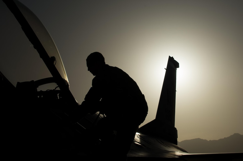 U.S. Air Force Senior Airman Joseph Santana, 455th Expeditionary Aircraft Maintenance Squadron crew chief, completes an F-16 Fighting Falcon aircraft post flight inspection at Bagram Airfield, Afghanistan, June 8, 2015. The 455th EAMXS ensure Fighting Falcons on Bagram are prepared for flight and return them to a mission-ready state once they land.  (U.S. Air Force photo by Tech. Sgt. Joseph Swafford/Released)