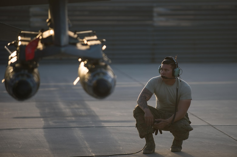 U.S. Air Force Staff Sgt. William Harris, 455th Expeditionary Maintenance Squadron crew chief, looks on during an F-16 Fighting Falcon aircraft preflight inspection at Bagram Airfield, Afghanistan, June 8, 2015. The 455th EAMXS ensure Fighting Falcons on Bagram are prepared for flight and return them to a mission-ready state once they land.  (U.S. Air Force photo by Tech. Sgt. Joseph Swafford/Released)