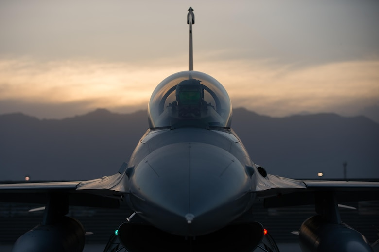 U.S. Air Force Capt. Doug Mayo, 555th Expeditionary Fighter Squadron F-16 Fighting Falcon aircraft pilot, goes through preflight inspection with Staff Sgt. William Harris, 455th Expeditionary Maintenance Squadron crew chief, before a combat sortie at Bagram Airfield, Afghanistan, June 8, 2015. The 455th EAMXS ensure Fighting Falcons on Bagram are prepared for flight and return them to a mission-ready state once they land.  (U.S. Air Force photo by Tech. Sgt. Joseph Swafford/Released)