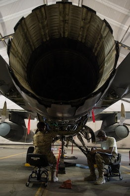 U.S. Air Force Staff Sgt. Donterrio Erby and Senior Airman Jaid Downing, both assigned to the 455th Expeditionary Maintenance Squadron, perform a 400-hour engine inspection on an F-16 Fighting Falcon aircraft at Bagram Airfield, Afghanistan, June 9, 2015. The 455th EAMXS ensure Fighting Falcons on Bagram are prepared for flight and return them to a mission-ready state once they land.  (U.S. Air Force photo by Tech. Sgt. Joseph Swafford/Released)
