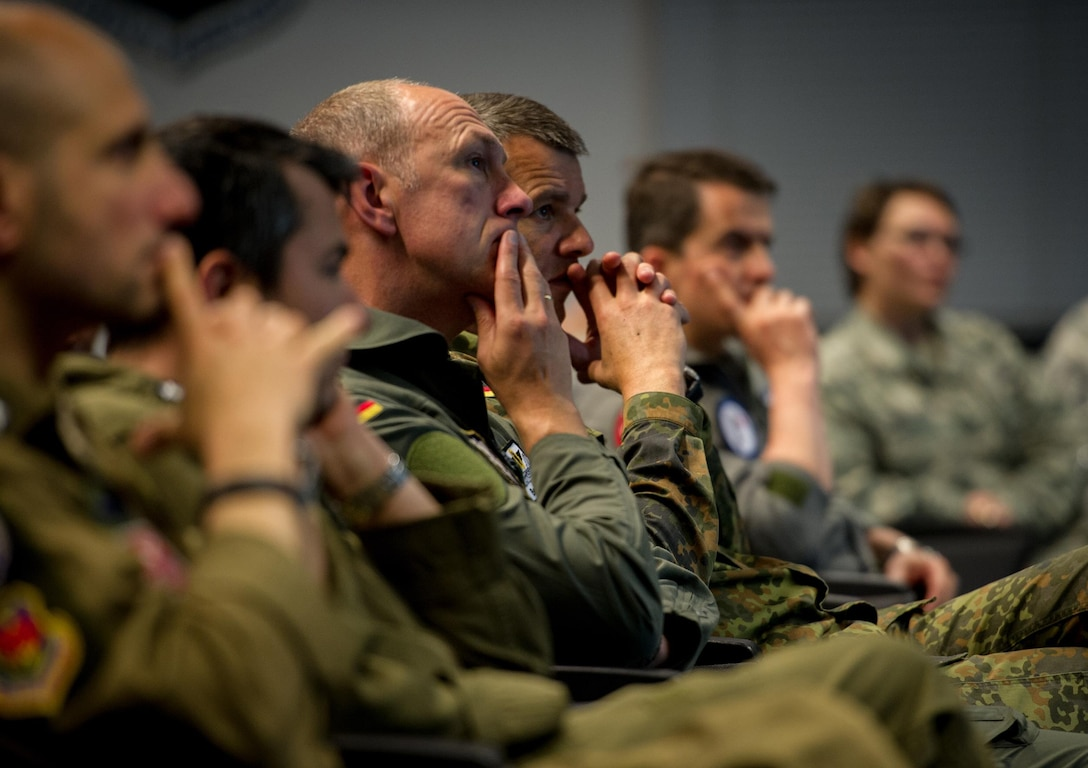 Senior enlisted and officers from multiple countries throughout Europe and Africa listen to a brief about the NCO professional military education course during the inaugural International Professional Military Development (PMD) Symposium at Ramstein Air Base, Germany, June 3, 2015. This inaugural PMD course was designed to bring allied and partner nations together to exchange ideas and best practices with the goal of improving their militaries. (U.S. Air Force photo/Tech. Sgt. Ryan Crane)