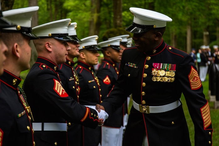 Sergeant Maj. of the Marine Corps Ronald L. Green shakes the hands of Marines with the 5th Marine Regiment prior to a private ceremony at Aisne-Marne American Cemetery in Belleau, France, May 31, 2015. This Memorial Day ceremony is held in honor of the 97th anniversary of the Battle of Belleau Wood. More than 1,800 Marines from the 5th and 6th Regiments lost their lives in the 21-day battle that stopped the last German offensive in 1918. (U.S. Marine Corps photo by Lance Cpl. Akeel Austin/Released)