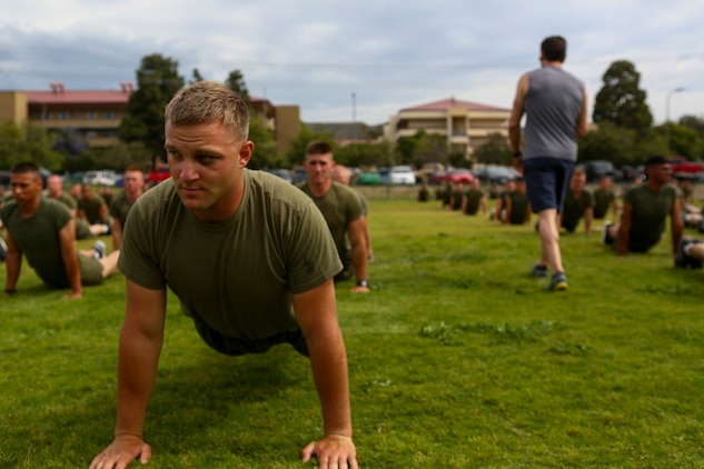 Corporal Justin Carpenter, a squad leader with 3rd Battalion, 5th Marine Regiment, conducts exercises with Tony Horton, the creator of the fitness program, P90X aboard Camp Pendleton, Calif., June 9, 2015. Horton believes Marines need to focus on nutrition and a wide variety of exercises to be ready for any mission as may be directed.