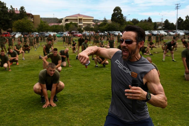 Tony Horton, the creator of P90X, instructs morning physical fitness for the Marines assigned to 3rd Battalion, 5th Marine Regiment, aboard Camp Pendleton, Calif., June 9, 2015. Horton believes Marines need to focus on nutrition and a wide variety of exercises to be ready for any mission as may be directed.