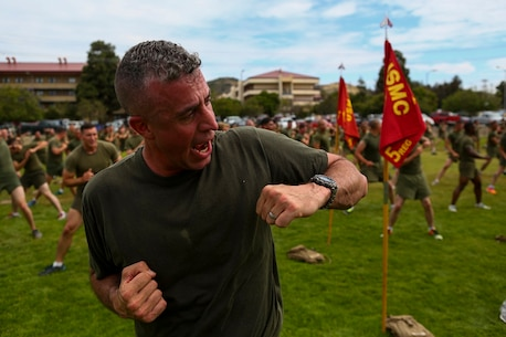 Lieutenant Colonel Hunter Rawlings, the commanding officer of 3rd Battalion, 5th Marine Regiment, conducts exercises during a visit from the creator of the fitness program P90X aboard Camp Pendleton, Calif., June 9, 2015. Horton believes Marines need to focus on nutrition and a wide variety of exercises to be ready for any mission as may be directed.
