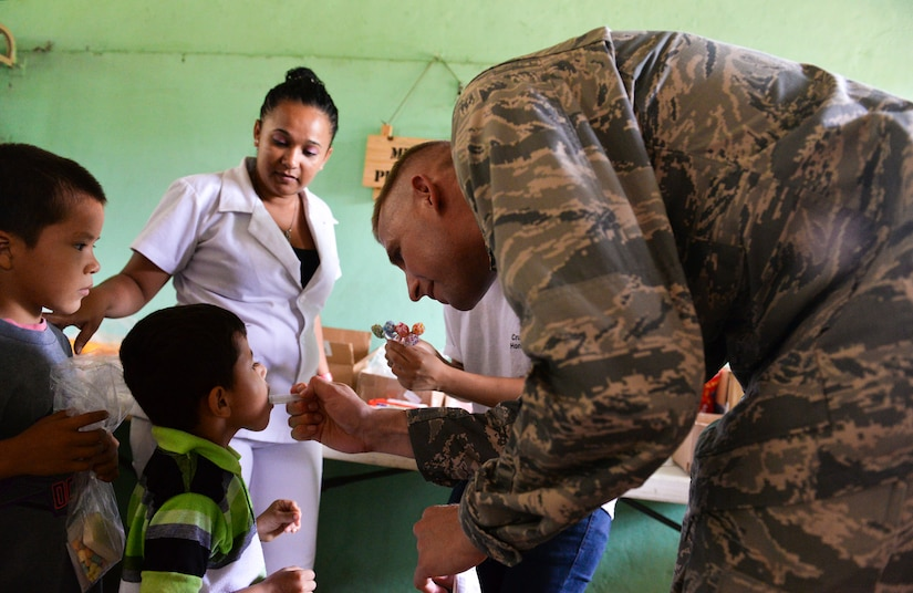 Capt. Christopher Watson, Joint Task Force – Bravo chaplain, administers medication to a patient during the Corinto, Cortes medical readiness training exercise June 2, 2015, at Corinto, Cortes, Honduras. During the MEDRETE more than 667 patients received medical screening, saw medical providers, received dental care, went through preventive medicine and received vaccines. (U.S. Air Force photo by Staff Sgt. Jessica Condit)