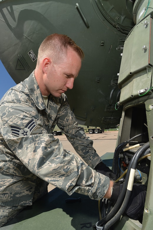 U.S. Air Force Senior Airman Jonathan R. Smail, a transmission technician from the 233rd Space Communications Squadron, Colorado Air National Guard, checks the cables hooked up to a mobile satellite trailer at Greeley Air National Guard Station, Greeley, Colo., June 7, 2015. Smail, who troubleshoots and maintains satellite communications electronic equipment for the 233rd's one-of-a-kind mobile nuclear and missile launch tracking mission, won the 2014 Air National Guardsman of the year. (Air National Guard photo by Tech. Sgt. Wolfram M. Stumpf)