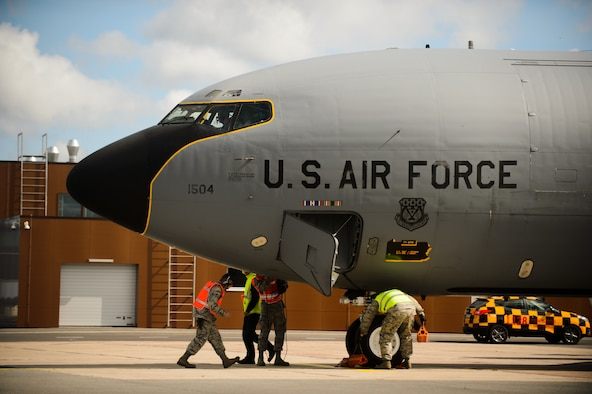 Airmen from the Pennsylvania & Michigan Air National Guard secure a KC-135 Stratotanker after completion of its sortie in support of a multilateral exercise June 9, 2015 at Riga International Airport, Latvia. Guardsmen from Maryland, Michigan and Pennsylvania came together to support Saber Strike 15 by providing aerial-refueling and close air support. Saber Strike 15 is a joint and multinational exercise designed to promote stability in the Baltic area and provide an opportunity for military members to sharpen their skills. (U.S. Air Force photo/ Staff Sgt. Armando A. Schwier-Morales)
