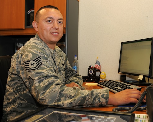 Tech. Sgt. Christopher Lucero, 348th Reconnaissance Squadron flight chief of plans and programs, works to keep personnel records in the squadron up to date June 9, 2015, on Grand Forks Air Force Base, N.D. Lucero was selected as the warrior of the week for the second week of June 2015. (U.S. Air Force photo by Senior Airman Zachiah Roberson/released)