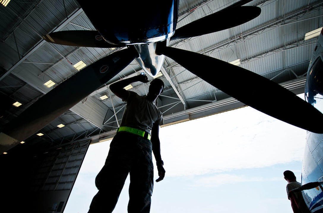 Airman Mario Hill, 919th Special Operations Maintenance Group, checks the intake of an engine on a C-145 June 6 at Duke Field, Fla. The 919th SOMXG is comprised of 919th SOMXS, 919th SOAMXS, 919th SOMOF, and the 592nd SOAMXS.  Their primary mission is the maintenance of the C-145 aircraft. (U.S. Air Force photo/Tech. Sgt. Sam King)