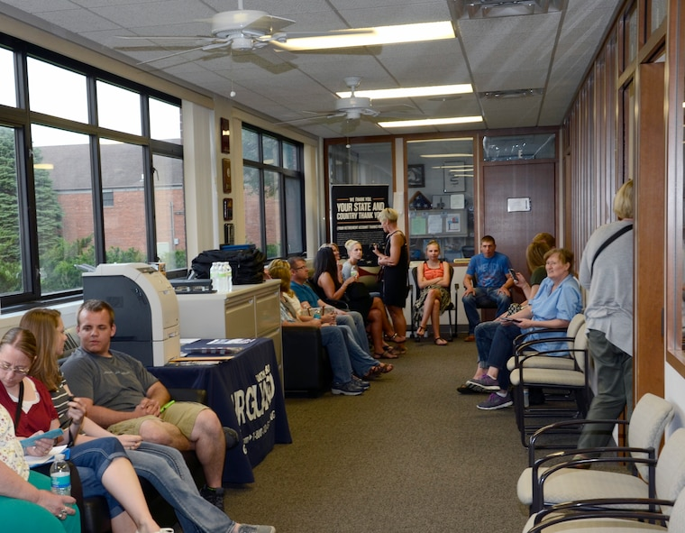 SIOUX FALLS, S.D. - New enlistees and their families wait patiently in the recruiting office for their turn to sign their enlistment contracts to join the South Dakota Air National Guard at Joe Foss Field, S.D. June 5, 2015.  114th Force Support Squadron personnel worked overtime to ensure these new members were enlisted before the deadline for them to recieve their enlistment bonus for joining the unit.(National Guard photo by Senior Master Sgt. Nancy Ausland/Released)