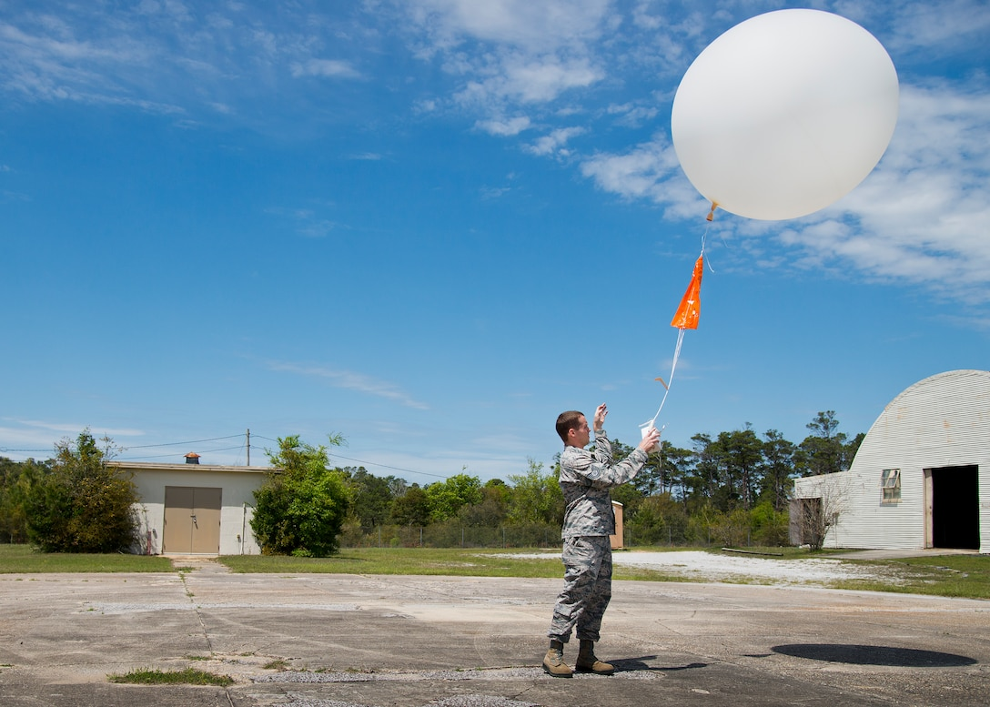 Tech. Sgt. Nathan Halvorson, 96th Weather Flight, releases a weather balloon to gather data for an aircraft test at Eglin Air Force Base, Fla.  (U.S. Air Force photo/Samuel King Jr.)