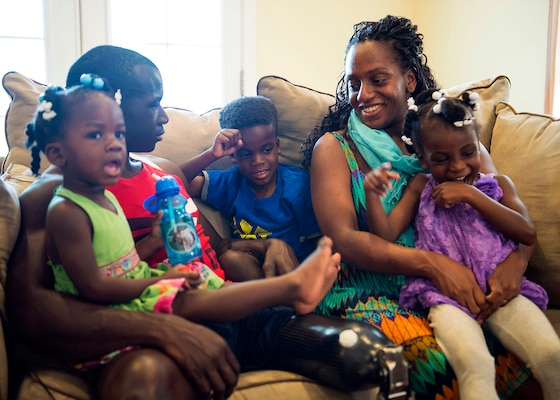 Retired Army Capt. Will Reynolds and his wife, Cassandra, relax at home with their children, Genevieve, 2, Malachi, 6, and Gabrielle, 4, May 27, 2015. The couple is expecting their fourth child in August. Reynolds is competing in the Department of Defense Warrior Games in June. DoD photo by U.S. Navy Petty Officer 3rd Class Timothy Haake