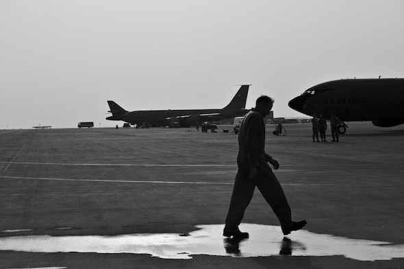 Brig. Gen. Darren E. Hartford 379th Air Expeditionary Wing commander, walks on the flight line after completing his fini flight in a KC-135 Stratotankers June 6, 2015. (U.S. Air Force photo/Staff Sgt. Alexandre Montes)