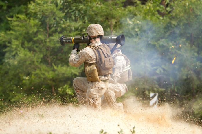 """A Marine from Company A, Marine Barracks Washington, D.C., employs an AT-4 rocket launcher at range 8 Alpha, Marine Corps Base Quantico, Va., June 10, 2015. Forty five Marines from A Co. conducted an M203 grenade launcher qualification course and M67 fragmentation grenade and AT-4 rocket launcher battle drills. The objective of this training was to instruct the Marines in the proper implementation of the weapon systems, said Capt. Mark Batey, executive officer, A Co., Marine Barracks Washington, D.C. """"The main focus of the range was to properly employ high explosives as a squad and the right way to use those assets as an infantry squad."""" (U.S. Marine Corps photo by Cpl. Skye Davis/Released)"""