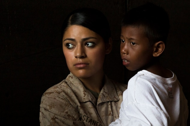 U.S. Marine Lance Cpl. Jasmine Castaneda comforts a distressed mariner aboard the USS Rushmore (LSD 47), after he was rescued from a sinking craft in the waters between the Indonesian islands of Kalimantan and Sulawesi, June 11, 2015. Castaneda is a supply warehouse clerk with Combat Logistics Battalion 15, 15th Marine Expeditionary Unit. Once on board, distressed mariners were provided food and medical attention by Marines and Sailors of the 15th MEU and Essex Amphibious Ready Group before being transferred to an Indonesian coast guard vessel. (U.S. Marine Corps photo by Sgt. Emmanuel Ramos/Released)
