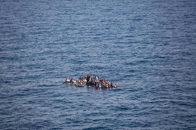 Distressed mariners wait to be rescued by U.S. Marines and Sailors with 15th Marine Expeditionary Unit and Essex Amphibious Ready Group aboard the USS Rushmore (LSD 47), at sea in the Makassar Strait, June 10, 2015. Sixty-five people were brought aboard Rushmore after it was discovered they were floating on bamboo rafts tied together with no means of propulsion. Once on board, evacuees were provided food and medical attention by Marines and sailors of the 15th Marine Expeditionary Unit and Essex Amphibious Ready Group. (U.S. Marine Corps photo by Sgt. Emmanuel Ramos/Released)