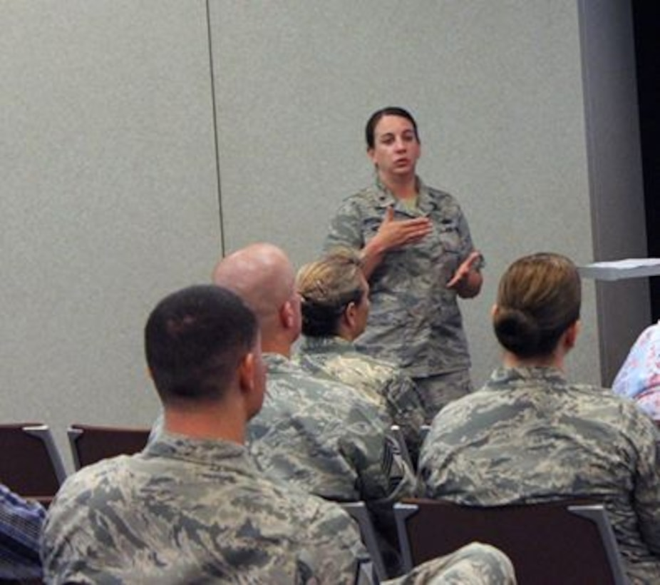 Maj. Amber Nichols, Headquarters Individual Reservist Readiness and Integration Organization project officer, addresses the audience June 11, 2015, during the Air Reserve Personnel Center's June Leadership Seminar at the ARPC headquarters building on Buckley Air Force Base, Colo. (U.S. Air Force photo/Tech. Sgt. Rob Hazelett)