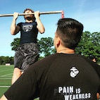 Staff Sgt. David Castro counts the pull-ups of Eric Duhamel, a running back for the East Bridgewater High School freshman football team of East Bridgewater, Mass., during the beginning hours of the Semper Fidelis All-American Camp at St. John Preparatory High School in Danvers, Massachusetts, June 7. Nearly 200 top football players from high schools throughout the New England states, including New York, Pennsylvania and New Jersey, received training from the NFL and college football coaches while fighting for a spot to play in the 2016 Semper Fidelis All-American Bowl game in California. Castro is a canvassing recruiter with Recruiting Substation Boston, Mass., Recruiting Station Portsmouth, New Hampshire.
