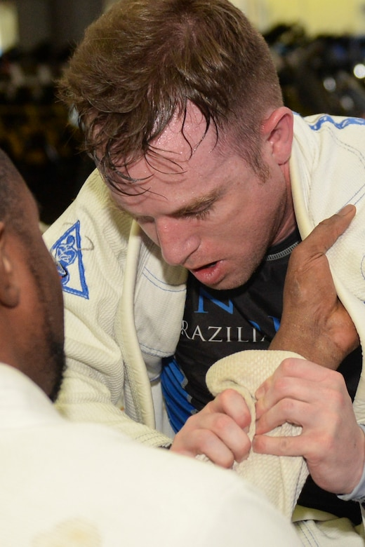 Staff Sgt. Ryan Underwood, 374th Communications Squadron, spars a fellow student during a jiu-jitsu class called Endure at Yokota Air Base, Japan, June 10, 2015. Part of jiu-jitsu techniques incorporates gripping the special garment the students wore, called a gi. (U.S. Air Force photos by Airman 1st Class Elizabeth Baker/Released)