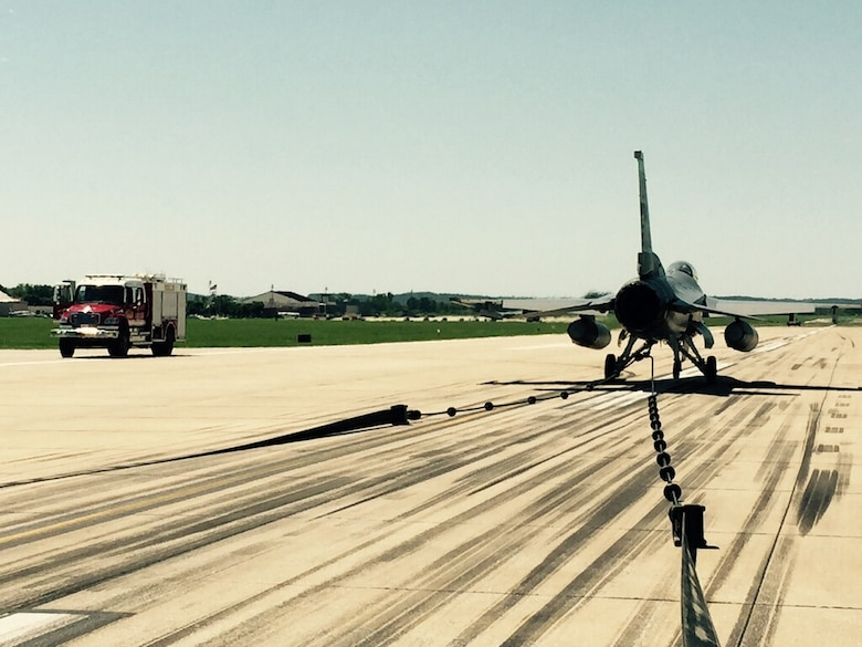 An F-16 Fighting Falcon from the 180th Fighter Wing, Ohio Air National Guard, sits on the runway at Rosecrans Air National Guard Base, St. Joseph, Mo., June 8, 2015. The aircraft was used to test and certify the use of a mobile aircraft arresting system, or MAAS, on the runway. The MAAS will be deployed at Rosecrans during the Wings Over Whiteman Airshow at Whiteman Air Force Base as a backup for the U.S. Air Force Thunderbirds should they need maintenance before or after the air show. (U.S. Air Force photo by Senior Airman Charles Puengpan)