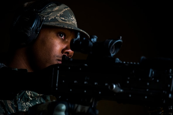 Senior Airman Vidarion McDaniel, a security forces airman for the 570th Global Mobility Readiness Squadron from Travis Air Force Base, Calif., waits to shoot during an attack scenario on a missile convoy while working as opposing forces against the 91st Missile Wing, assigned to Minot Air Force Base, N.D., during Operation Road Warrior at Camp Guernsey, Wyo., May 19, 2015.  Operation Road Warrior, the largest security forces exercise conducted each year, is an Air Force Global Strike Command exercise held annually at Camp Guernsey, Wyo., which evaluates tactics, techniques, and procedures used to secure nuclear–capable weapons and critical intercontinental ballistic missile (ICBM) components during convoy operations and provided direct feedback to the three participating ICBM wings; the 91st Missile Wing, assigned to Minot AFB, N.D., 90th Missile Wing assigned to F.E. Warren AFB, Wyo., and 341st Missile Wing assigned to Malmstrom AFB, Mont.. (U.S. Air Force photos by Tech. Sgt. Matthew Hannen)