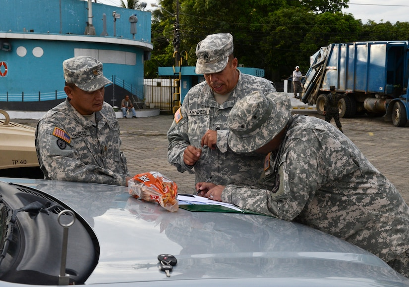 Sgt. Anthony Mendoza, a Joint Task Force – Bravo Joint Security Forces military police officer, reviews the outgoing convoy plan during the Corinto, Cortes medical readiness training exercise, June 4, 2015, at Puerto Cortes Naval Station, Honduras. The MEDRETE convoy consisted of more than 15 military vehicles, which were escorted to and from site by JSF personnel. (U.S. Air Force photo by Staff Sgt. Jessica Condit)
