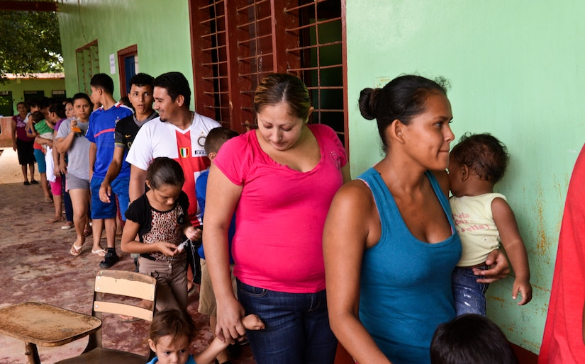 Families wait in line to participate in the health education class and receive medication during a medical readiness training exercise, June 2, 2015, at Corinto, Cortes, Honduras. Each family was provided the opportunity to learn proper procedures for treating illness and hygiene and was given any necessary medication. (U.S. Air Force photo by Staff Sgt. Jessica Condit)