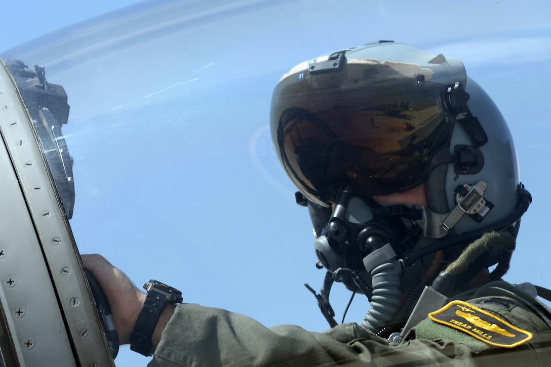 U.S. Air Force Capt. Christopher Mills, 493rd Fighter Squadron pilot, prepares for flight during Anatolian Eagle 15 at 3rd Main Jet Base, Turkey, June 10, 2015. The 493rd FS recently received the 2014 Raytheon Trophy as the U.S. Air Force's top fighter squadron. (U.S. Air Force photo by Tech. Sgt. Eric Burks/Released)