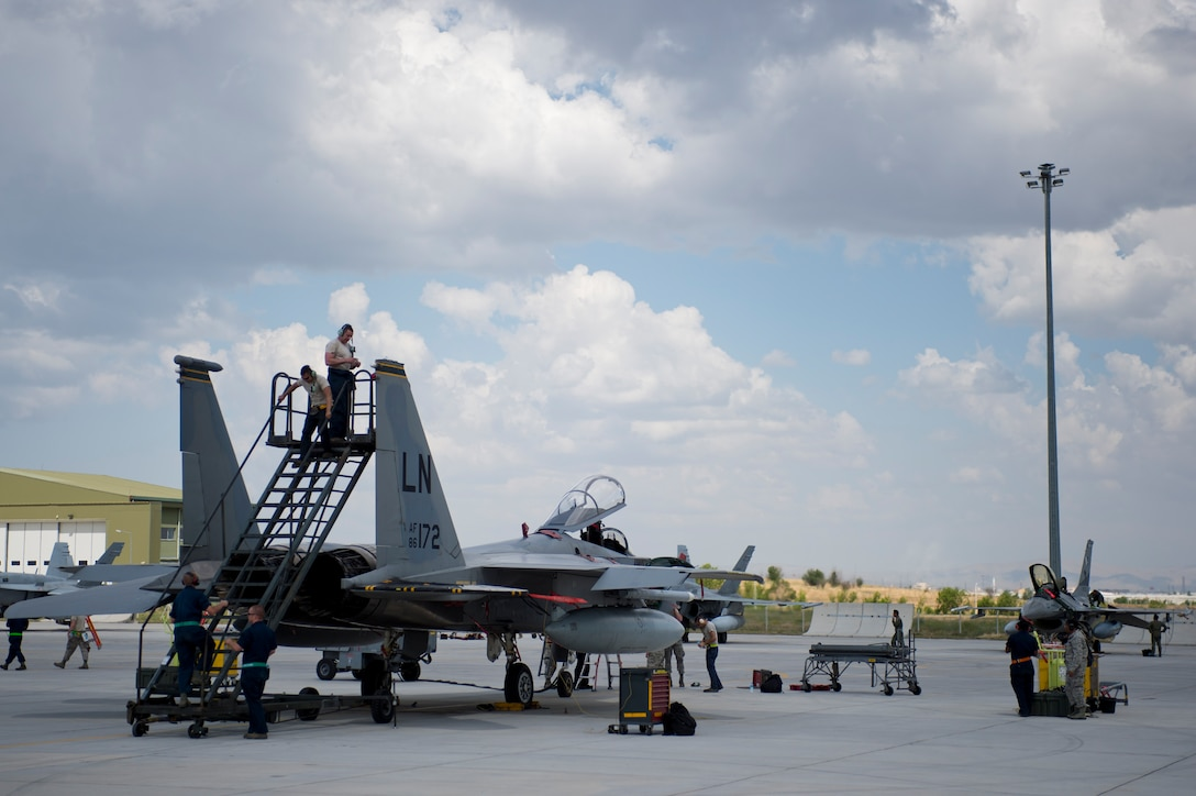 48th Fighter Wing Airmen work on an F-15C Eagle from the 493rd Fighter Squadron during Anatolian Eagle 15 at 3rd Main Jet Base, Turkey, June 10, 2015. Approximately 250 personnel and 12 F-15 aircraft from the 48th FW, Royal Air Force Lakenheath, England, are participating in the two-week exercise. (U.S. Air Force photo by Tech. Sgt. Eric Burks/Released)