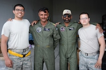 U.S. Air Force Staff Sgt. Jesus Trevino, far left, and Senior Airman Alex Ross, far right, both 748th Aircraft Maintenance Squadron, pose for a photo with Pakistan Air Force crew chiefs during Anatolian Eagle 15 at 3rd Main Jet Base, Turkey, June 10, 2015. Anatolian Eagle is a two-week flying training exercise involving U.S. Air Forces in Europe units and multiple NATO partners. (U.S. Air Force photo by Tech. Sgt. Eric Burks/Released)