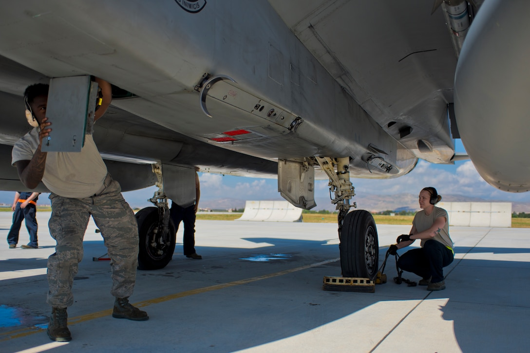 Maintainers from the 748th Aircraft Maintenance squadron prepare an F-15C Eagle assigned to the 493rd Fighter Squadron, Royal Air Force Lakenheath, England, during an Anatolian Eagle 15 mission at 3rd Main Jet Base, Turkey, June 10, 2015. Maintainers are responsible for overseeing the day-to-day maintenance of aircraft, including diagnosing malfunctions and replacing components, and conducting various inspections to ensure the aircraft is functioning properly. (U.S. Air Force photo by Tech. Sgt. Eric Burks/Released)