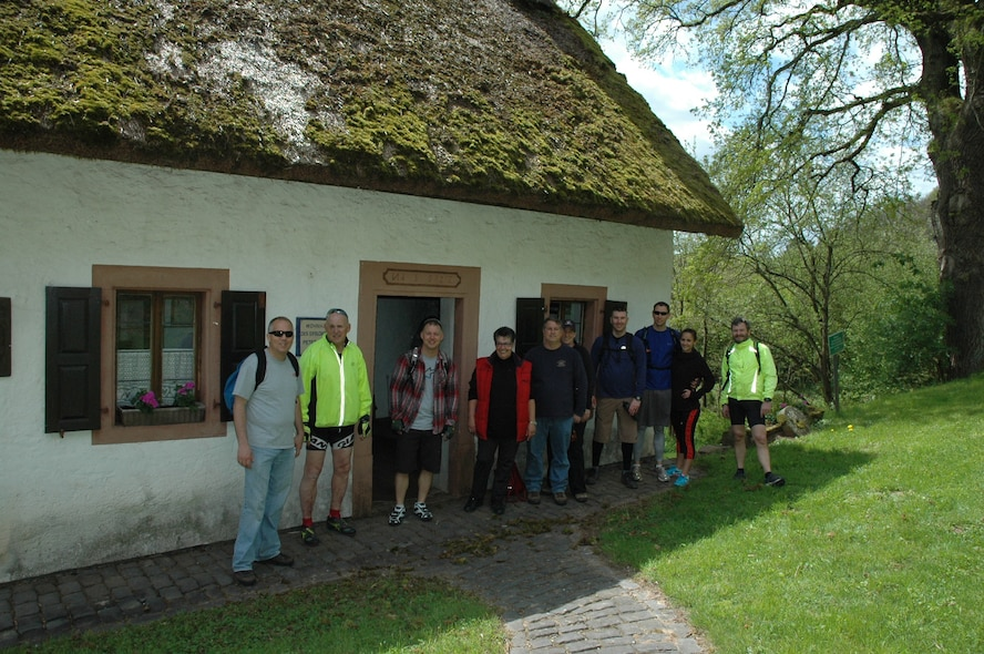 A group of Explore the Eifel bikers and walkers followed an invitation by Mayor Illigen and the bike tour organizer, Thomas Gruber,  explored  the small museum and other attractions. The Peter Zirbes House and Museum attracts people year-round and will be open to visitors at 2 p.m. Sunday, June 14, 2015. Local village residents will read poems from Peter Zirbes to visitors. . The Peter Zirbes House shows the original household environment with items from the past, giving visitors a good impression on how the poet lived and worked. (Courtesy photo)