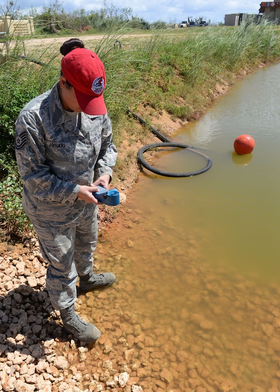Tech. Sgt. Roshia Johari, 554th RED HORSE NCO in charge of water and fuels systems maintenance contingency training, uses an ultrameter to measure the total dissolved solids to test the quality of a water source June 9, 2015, Andersen Air Force Base, Guam. The Reverse Osmosis Water Purification Unit's purification process starts with finding a viable water source, which could be fresh, brackish or saltwater. (U.S. Air Force photo by Airman 1st Class Joshua Smoot/Released)