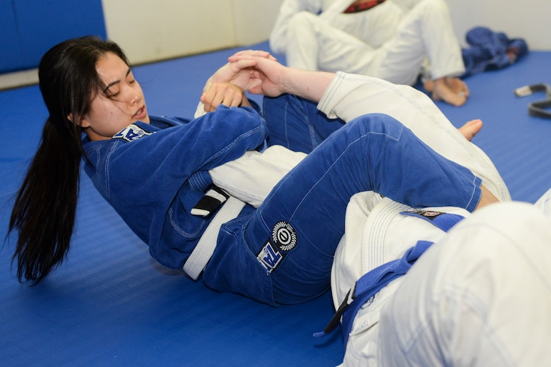 A student of Endure, a jiu-jitsu class, puts her opponent in an arm-bar at Yokota Air Base, Japan, June 10, 2015. Jiu-jitsu is a martial art which focuses on manipulating joints rather than throwing and striking. (U.S. Air Force photos by Airman 1st Class Elizabeth Baker/Released)