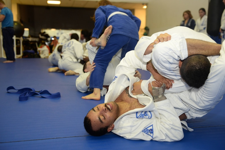 Students of Endure, a jiu-jitsu class, spar at Yokota Air Base, Japan, June 10, 2015. Sparing, which took place after practice drills, was more intense and fast-paced. (U.S. Air Force photos by Airman 1st Class Elizabeth Baker/Released)