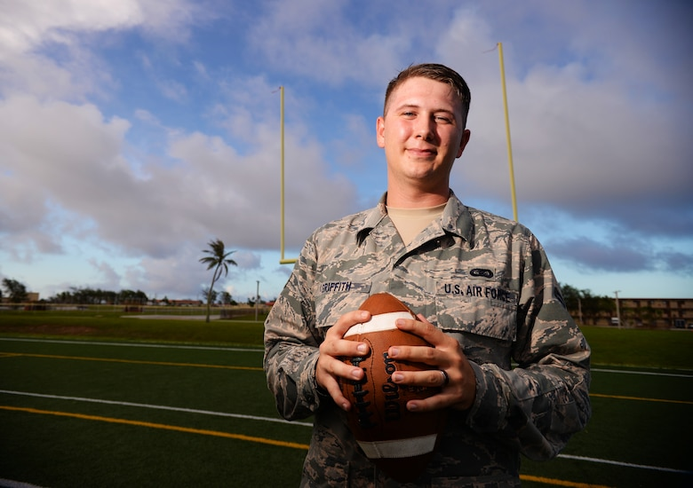 Senior Airman Presley Griffith, 36th Mobility Response Squadron executive assistant, offers a free football spring practice camp as volunteer coach at Andersen Air Force Base, Guam. A former high school quarterback, Griffith is working toward his goal of becoming a high school football coach. (U.S. Air Force photo by Senior Airman Alexander W. Riedel/Released)