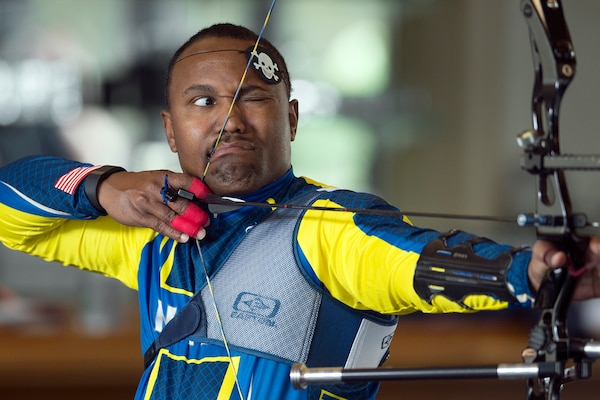 Navy Chief Petty Officer Averill Malone focuses on an archery target during the Navy's training camp for the 2015 DoD Warrior Games at Ventura County Naval Station Port Hueneme in Oxnard, Calif., May 31, 2015. DoD photo by EJ Hersom