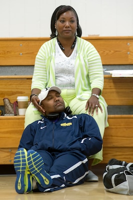 Navy Chief Petty Officer Averill Malone rests on his wife, Ida, during the Navy's training camp for the 2015 DoD Warrior Games at Ventura County Naval Station Port Hueneme in Oxnard, Calif., June 3, 2015. DoD photo by EJ Hersom