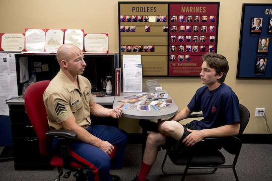 Sgt. Cody Leifheit, a Marine recruiter in Lewiston, Idaho, answers enlistee Brandon Roberts' questions about the Marine Corps at his recruiting office June 10, 2015. Leifheit, a 28-year-old infantry Marine from Ferndale, Washington, responded to a 19-year-old man hanging himself from a tree outside his house June 7. Without hesitation, Leifheit climbed up the tree 25 feet and took hold of the man, who wasn't breathing and lacked a pulse. Leifheit worked to keep him alive until first responders arrived, continuously performing chest compressions as the man faded in and out. Despite spending 48 hours in a coma, the man survived. (U.S. Marine Corps photo by Sgt. Reece Lodder)