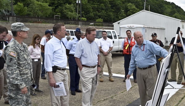 Chairman Mike Simpson (right), House Energy and Water Development Appropriations Subcommittee, and Congressman Tim Murphy (middle) receive a overview of Locks and Dam 4 on the Monongahela River at Charleroi, Pa., from Steve Fritz (far right), a Pittsburgh District civil engineer, June 5.