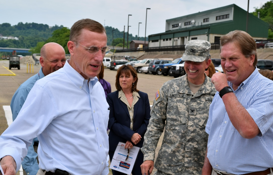 Chairman Mike Simpson (right), House Energy and Water Development Appropriations Subcommittee, and Congressman Tim Murphy (left) share a laugh with Col. Bernard Linstrom, U.S. Army Corps of Engineers Pittsburgh District commander, during a tour of Locks and Dam 4 on the Monongahela River at Charleroi, Pennsylvania, June 5.