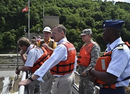 The tour group including Chairman Mike Simpson (left), House Energy and Water Development Appropriations Subcommittee, Congressman Tim Murphy (middle), and Col. Bernard Linstrom, U.S. Army Corps of Engineers Pittsburgh District commander, take a bird's-eye view of Charleroi Locks and Dam 4 on the Monongahela River, June 5.