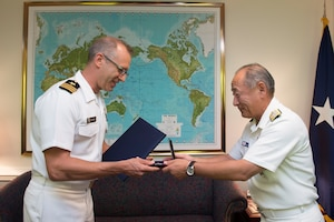 Japan Chief of Defense Adm. Katsutoshi Kawano presents Japan's Defense Cooperation Award to Cmdr. Daniel Fillion in appreciation for his work as a Japan country officer on the Joint Staff.