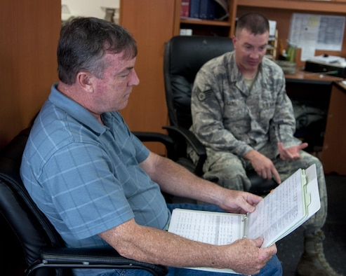 Richard Mullee, the 90th Missile Wing Safety Office missile safety superintendent, reviews the 90th Missile Maintenance squadron checklists during an annual weapons safety inspection June 9, 2015, on F.E. Warren Air Force Base, Wyo. The office reviews checklists and guidance to assist Airmen on the job, while remaining safe in their work environment. (U.S. Air Force photo/Airman 1st Class Malcolm Mayfield)